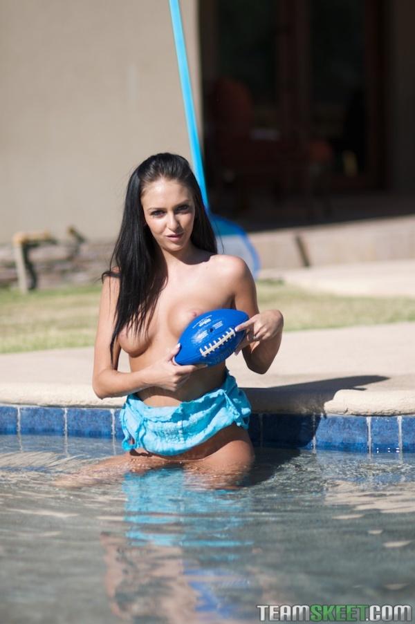 Stephanie Cane nude outdoors with a blue mini football